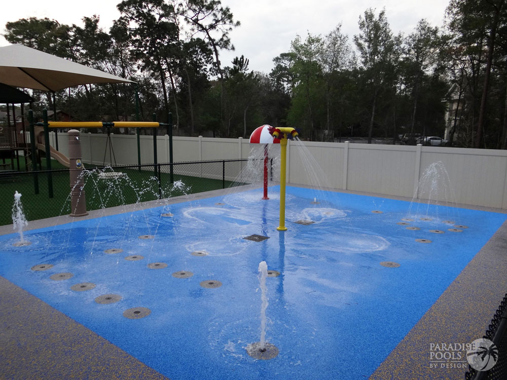 Splash pads gallery paradise pools by design for Pools by design